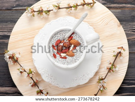 Chia seed pudding with nuts and goji berries - stock photo