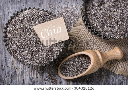Chia seeds in a old muffin cup - stock photo