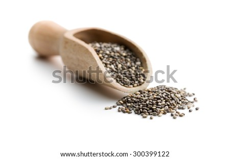 chia seeds in scoop on white background - stock photo