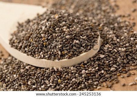 chia seeds on wooden surface - stock photo