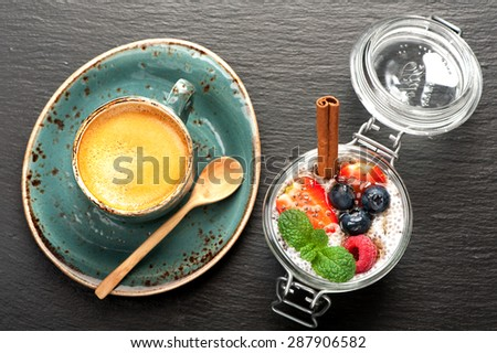 Chia seeds pudding with berries and cup coffee espresso - stock photo