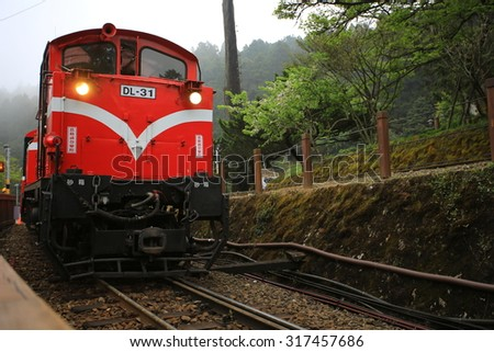 CHIAI;TAIWAN,APRIL 12: the train, Alishan Forest Railway, departure from the station in Alishan in Chiai Country on 12 april 2015. Alishan forest railway is the main transport in Alishan mountain area