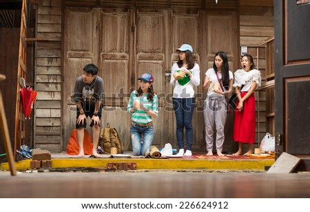 CHIANG KHAN, THAILAND - Oct 24, 2014 : Unidentified tourists offering sticky rice to Buddhist monk and Buddhist novice in the morning on Oct 24, 2014 at Chiang Khan, Loei, Thailand. - stock photo