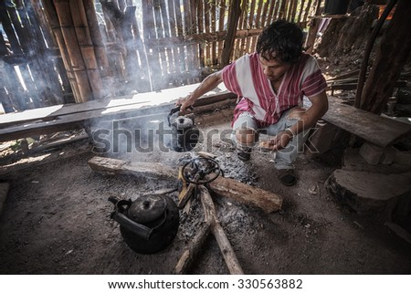 Chiang Mai,Oct 17: Indigenous men were made to drink the coffee. At Ban Mae Klang Luang, Chiang Mai, Thailand. on Oct 17, 2015. - stock photo