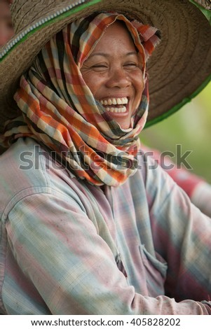 Chiang Mai province, Thailand,- July 2005: during the monsoon in july, a woman taking a break in the paddy fields  - stock photo