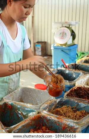 CHIANG MAI, THAILAND-APR25 : Native female merchant of pickle shop and her customer while doing work at a local yunnan market in chiang mai, On Apr 25, 2014, in Chiang Mai, Thailand.