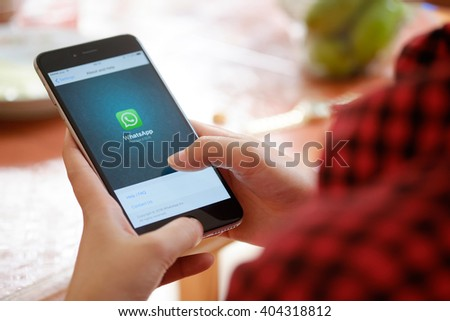 CHIANG MAI, THAILAND - APR 12 2016 : Young female holding a iPhone 6 plus with social Internet service WhatsApp on the screen. iPhone 6 plus was created and developed by the Apple inc. - stock photo