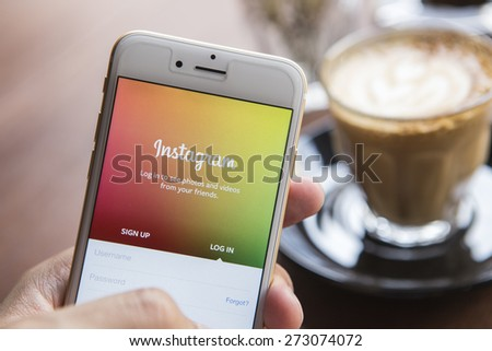 CHIANG MAI, THAILAND - APRIL 22, 2015: A man trying to log in Instagram application using Apple iPhone 6. Instagram is largest and most popular photograph social networking site in the world.