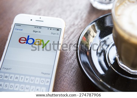 CHIANG MAI, THAILAND - APRIL 22, 2015: Close up of ebay app on a Apple iPhone 6 screen. ebay is one of the largest online auction and shopping websites. - stock photo