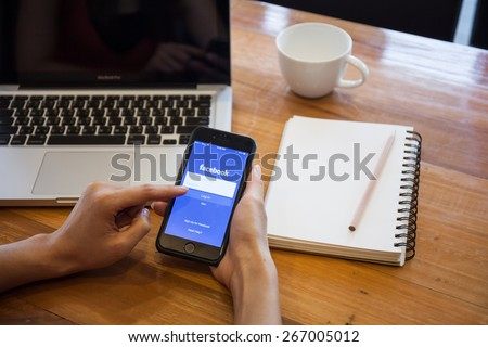 CHIANG MAI, THAILAND - APRIL 5, 2015: Facebook application sign in page on Apple iPhone. Facebook is largest and most popular social networking site in the world. - stock photo