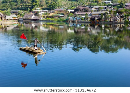Across river with his daughter in china village at north of thailand