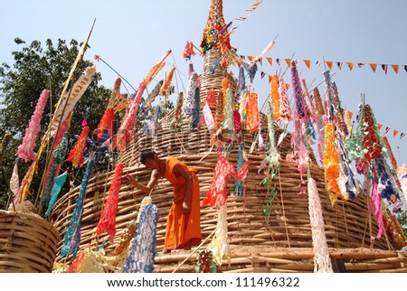 CHIANG MAI THAILAND - APRIL 14 : In Songkran festival or Water festival, Buddhist monk pin traditional flags on sand pagoda. APRIL 14,2011 in Phan-Tao Temple, Chiangmai province, Northern Thailand. - stock photo