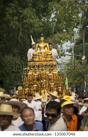 CHIANG MAI THAILAND - APRIL 13 : Songkran festival, Parade of Phra Sihing Buddha around the city . APRIL 13,2013 in  Phra Singh Temple, Chiangmai, Thailand.