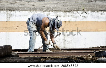 CHIANG MAI,THAILAND - AUGUST 2: Thai worker repairing railway at Chiang mai railway station on August 2,2014.