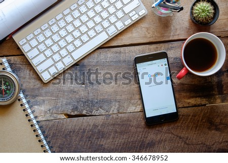 CHIANG MAI,THAILAND, DEC - 03 -2015 :iPhone 6 Space Gray with social networking service Google on the screen. iPhone 6 was created and developed by the Apple inc. - stock photo