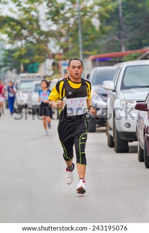 Chiang Mai, THAILAND - 13 Dec 2014 - Unidentified athletes run in Walk and Run Supper Mini-marathon race at Fang district, Chiang Mai, Thailand. - stock photo