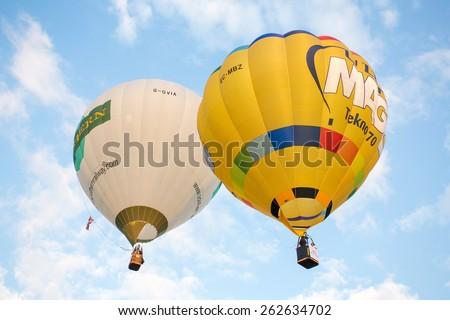 CHIANG MAI, THAILAND - DECEMBER 6, 2014: Hot air balloons in the sky during Thailand International Balloon Festival in Chiang Mai on December 6, 2014 in Chiang Mai, Thailand - stock photo