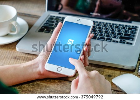 CHIANG MAI,THAILAND - FEB 11,2016: iPhone 6 plus with social network service LinkedIn on the screen. iPhone 6 plus was created and developed by the Apple inc. - stock photo