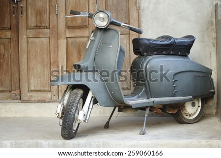 CHIANG MAI,THAILAND-FEB22 : old vespa parked in front of a house for show.,On Feb 22, 2015 in Chiang Mai, Thailand. - stock photo
