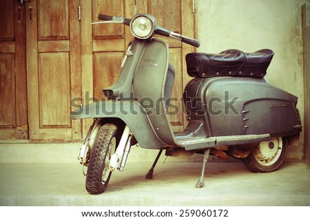 CHIANG MAI,THAILAND-FEB22 : old vespa parked in front of a house for show (post process to be vintage style picture).,On Feb 22, 2015 in Chiang Mai, Thailand. - stock photo