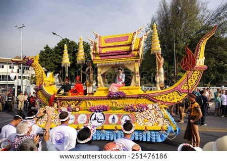 CHIANG MAI,THAILAND - FEB.7 : 39 th Anniversary Chiang Mai Flower Festival 2015, Unidentified men and women in parade annual Chiang Mai flower festival. on Feb.7, 2015 in Chiang Mai,Thailand. - stock photo