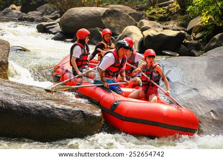 CHIANG MAI, THAILAND - FEBRUARY 12 : White water rafting on the rapids of river Maetang on FEBRUARY 12, 2015 in Chiang Mai, Thailand.  Maetang river is one of the most dangerous rivers of Thailand. - stock photo