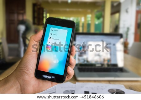 CHIANG MAI, THAILAND - JULY 07,2016: A man holds Apple iPhone 6S with Instagram application 3D Touch on the screen. Instagram is a photo-sharing app for smartphones. - stock photo