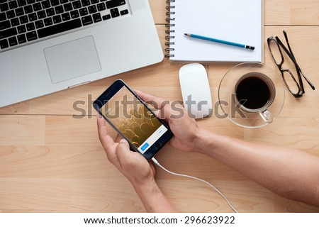 CHIANG MAI,THAILAND - JULY 15,2015 : Person holding  Apple iPhone 6 plus with Twitter login on the screen. Twitter is a social media online service for microblogging and networking communication. - stock photo