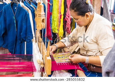 CHIANG MAI, THAILAND - JUN 05 : Unidentified old woman weaving sarong Teenjok (Traditional Cotton Woven ) on Jun 05, 2015 in Chiang Mai, Thailand.