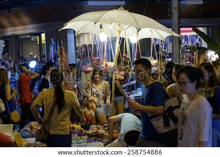 CHIANG MAI THAILAND - MARCH 8 : Sunday market walking street, Night marketing and trading of local tourists come to buy as souvenirs. on March 8 , 2015 in Chiang Mai, Thailand. - stock photo