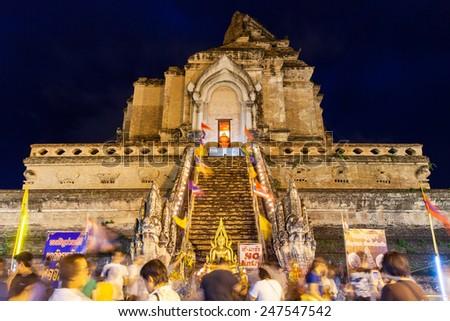 Chiang Mai, Thailand - 29 May, 2014: Crowd of people worshiping at Wat Chedi Luang during City Pillar Festival ( Inthakin Festival) on 29 May 2014, Chiang Mai, Thailand.  - stock photo
