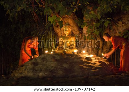 CHIANG MAI THAILAND - May 24 : Visakha Bucha Day is the most important incidents Buddhist day. Buddhist monk fire candles to the Buddha. May 24,2013 in Phan Tao Temple, Chiangmai, Thailand.