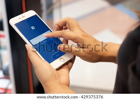 CHIANG MAI ,THAILAND - May 31, 2016: Young woman sign in Facebook application page on Apple iPhone 6 plus. Facebook is largest and most popular social networking site in the world.