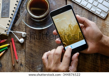 CHIANG MAI,THAILAND, NOV - 29 -2015 : A man trying to log in Twitter application using Apple iPhone 6. Twitter is largest and most popular social networking site in the world. - stock photo