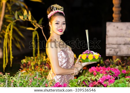 CHIANG MAI,THAILAND-NOVEMBER 13,2015 : Asian woman wearing typical thai dress and hold kratong, identity culture of thailand,Loy Kratong Festival,NOVEMBER 13,2015 in Chiang Mai Thailand - stock photo