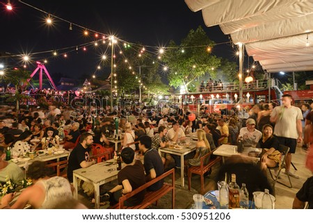 CHIANG MAI THAILAND - NOVEMBER 14, 2016 : Full Moon day, Unidentified many tourists Reservation table to celebrate & watch the spectacle the full moon. tonight's match with Thailand's Loy Krathong.