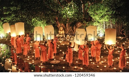 CHIANG MAI THAILAND-NOVEMBER 28 : Loy Krathong festival in Chiangmai.Traditional monk Lights floating balloon made of paper annually at Wat Phan Tao temple.on November 28,2012 in Chiangmai,Thailand - stock photo