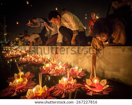 Chiang Mai, Thailand - November 8, 2014: People float lanterns in the river to worship river goddess in Loy Kratong festival on November 8, 2014 in Bankok, Thailand. - stock photo