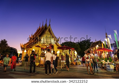 CHIANG MAI THAILAND - NOVEMBER 21 : Srisuphan temple market, Unidentified men and women tourists buy souvenirs and food. This temple is an important place to visit. Market is held every Saturday. - stock photo