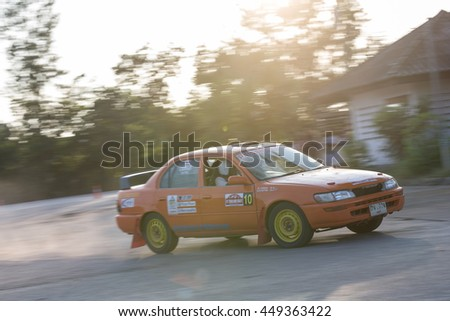 CHIANG MAI, THAILAND - November 04: Unknown car driver piloting his car on the tracks, November 04, 2015 in Chiang Mai, Thailand.