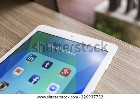 CHIANG MAI, THAILAND - OCTOBER 21, 2014: All of popular social media icons on Apple ipad air tablet device screen. - stock photo