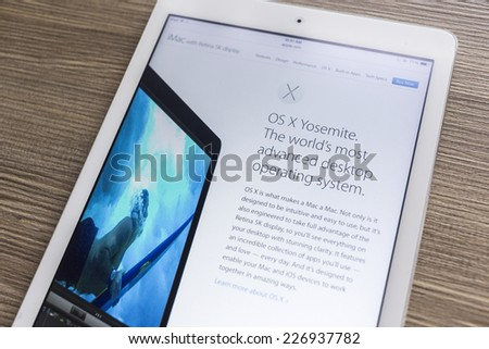 CHIANG MAI, THAILAND - OCTOBER 21, 2014: Apple Computers website with the newly launched Apple iMac with retina 5K display seen on Apple iPad Air. - stock photo