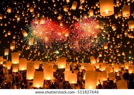 CHIANG MAI,THAILAND- OCTOBER 25 :People release sky lanterns to worship Buddha's relics in Yi Peng festival on  October 25,2014 in Chiangmai,Thailand.