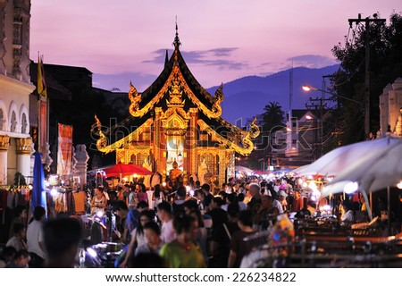 CHIANG MAI THAILAND - OCTOBER 19 : Sunday market walking street, The city center Thai temple marketing and trading of local tourists come to buy as souvenirs. on Oct. 19,2014 in Chiang Mai, Thailand. - stock photo