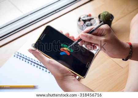 CHIANG MAI,THAILAND - SEP 16,2015  A woman hand holding Samsung note3 open Google wallet app. - stock photo