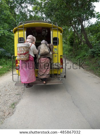 CHIANG MAI, THAILAND - SEPTEMBER 12, 2015: A minibus stop receiving the hill tribe in the way home after finished farm which the distance is far away.