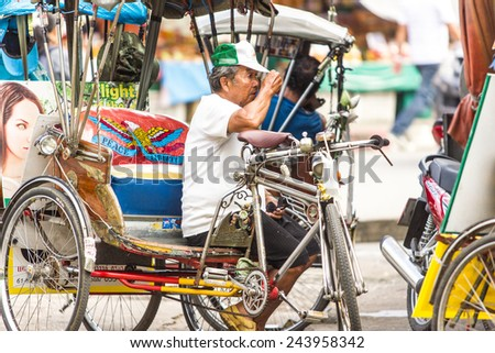 CHIANG MAI , THAILAND - SEPTEMBER 23 : An unidentified man sit on his tricycle (called Sam-Lor in Thai )  on September 23 , 2014 in Chiang Mai , Thailand . - stock photo