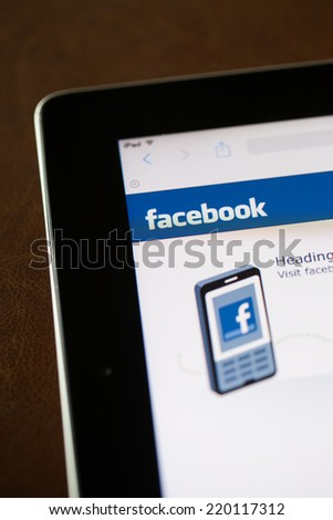 CHIANG MAI, THAILAND - SEPTEMBER 28, 2014: Facebook application sign in page on Apple iPad. Facebook is largest and most popular social networking site in the world. - stock photo