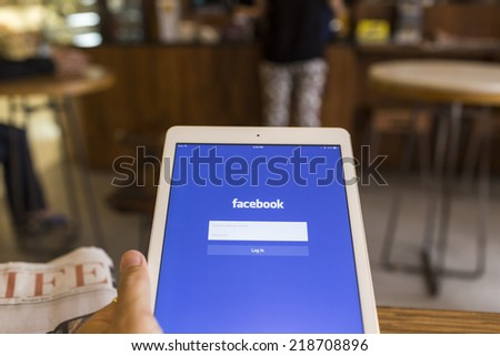 CHIANG MAI, THAILAND - SEPTEMBER 17, 2014: Facebook application sign in page on Apple iPad Air. Facebook is largest and most popular social networking site in the world. - stock photo