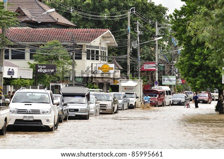 CHIANG MAI THAILAND - SEPTEMBER 28 : Flooding the Chiangmai city.Flood level of the traffic is going to be difficult on September 28,2011 in Chiangmai Thailand - stock photo